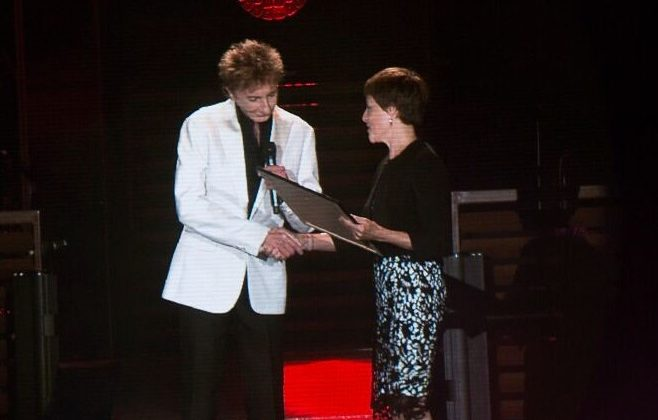 Barry Manilow on stage receiving an award.