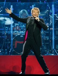 Barry Manilow singing and dancing live.